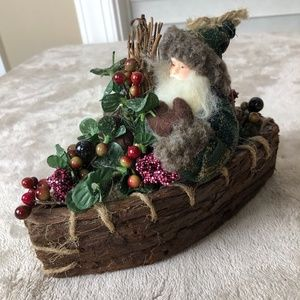 Rustic Santa in Bark Canoe